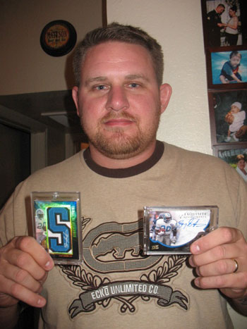 Josh showing off two of his favorite Upper Deck Barry Sanders autograph cards.