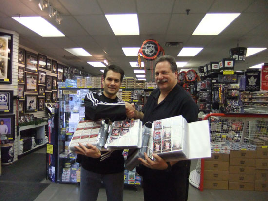 Wayne Wagner of Wayne's Sportscards congratulates Boleska on putting together the entire 20th Anniversary set.