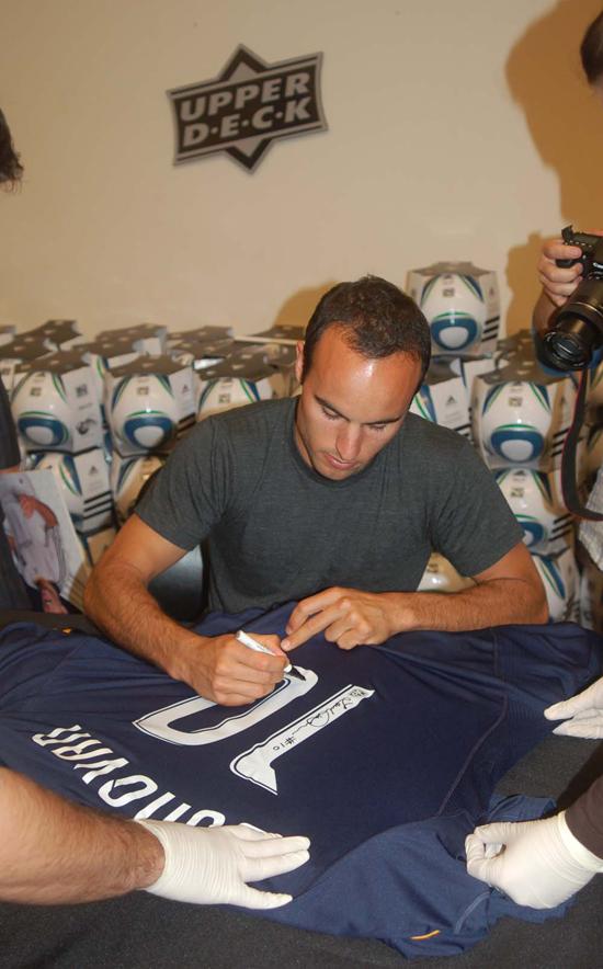 Landon Signs his L.A. Galaxy Away Jerseys.