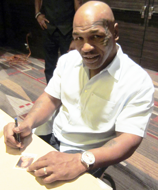 Mike Tyson signs Upper Deck Goodwin Champions Cards