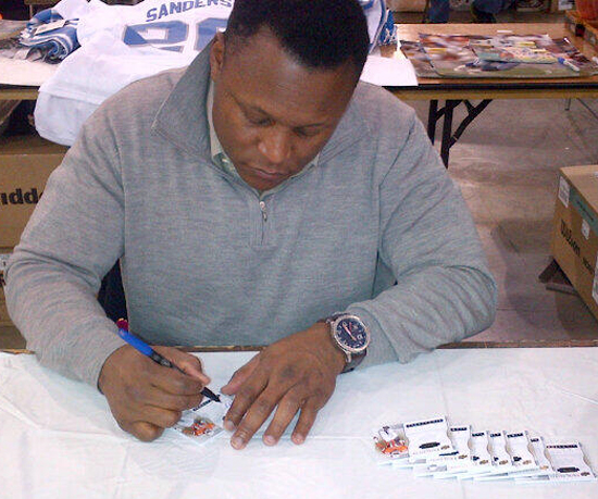 Barry-Sanders-Signing-Exquisite-Football
