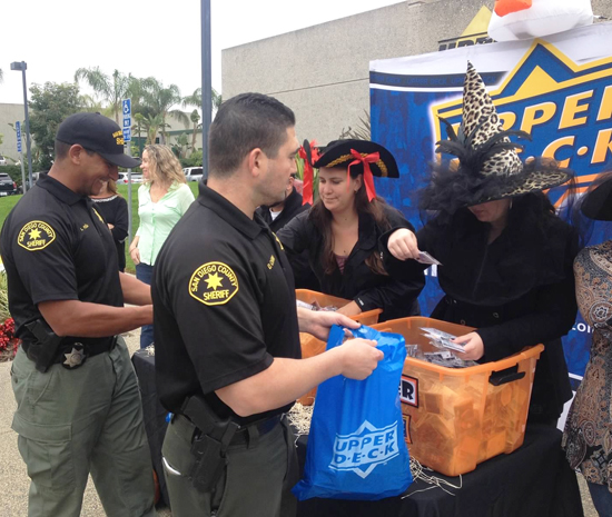 Upper-Deck-Trick-or-Trade-Halloween-Police-Officers-Pick-Up-Packs-at-Headquarters