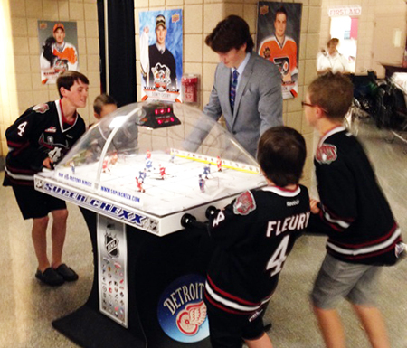 2014-NHL-Draft-Upper-Deck-Booth-Busy-Bubble-Hockey-Haydn-Fleury-2